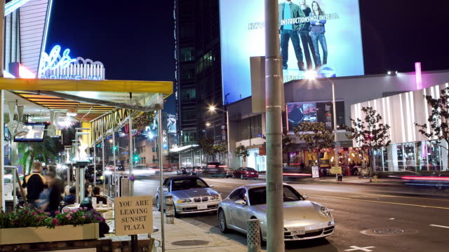 stockvideo's en b-roll-footage met ws zi t/l sunset strip at night with 50s diner outdoor seating on sidewalk / west hollywood, california, usa   - west hollywood