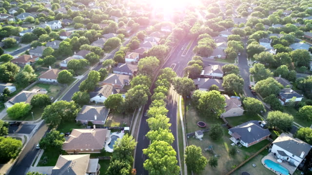 sunset suburb real estate market - drone point of view stock videos & royalty-free footage