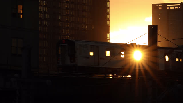 sunset subway train - elevated train stock videos & royalty-free footage