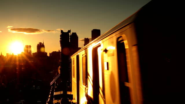 sunset subway train - elevated train stock videos and b-roll footage