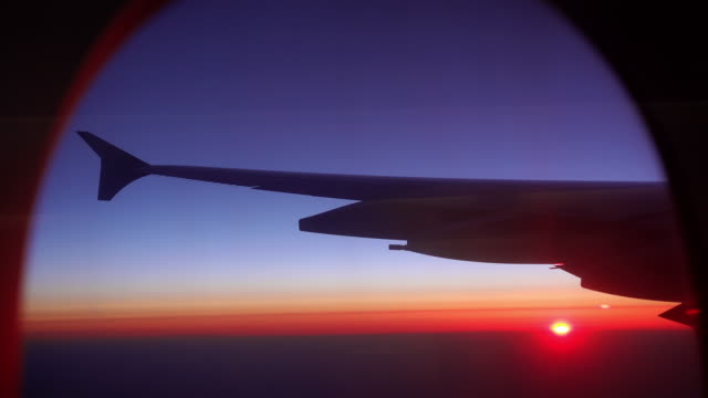 sunset sunrise flight airplane window view with wing - in silhouette stock videos & royalty-free footage