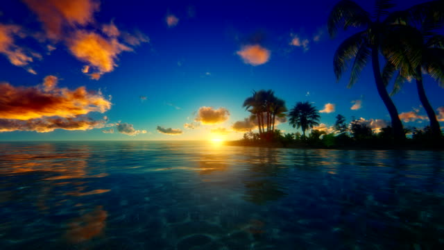 sunset / sunrise over tropical island - tropical climate stock videos & royalty-free footage
