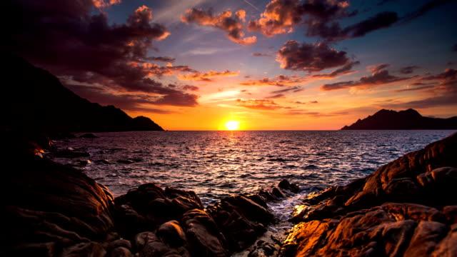 sunset / sunrise sea - rocky coastline stock videos & royalty-free footage