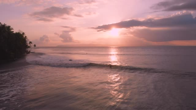 sunset surf - costa rica stock videos & royalty-free footage