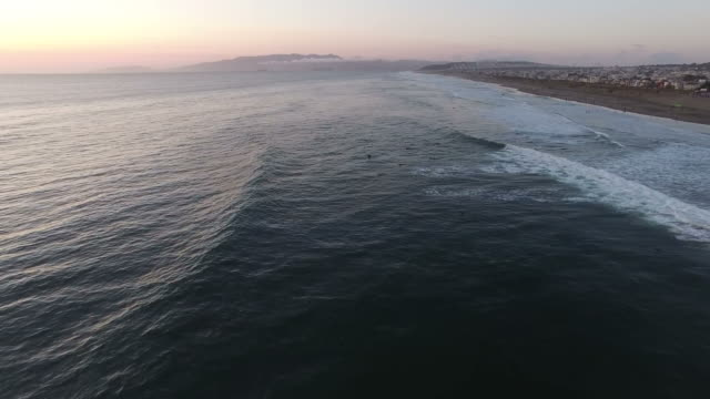 sunset surfers in the surf - san francisco bay area stock videos & royalty-free footage