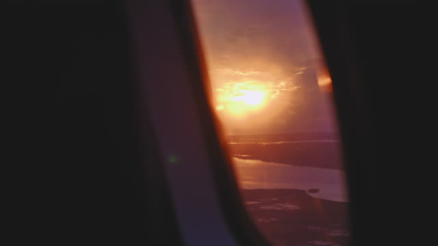 sunset through airplane window - arrival stock videos & royalty-free footage
