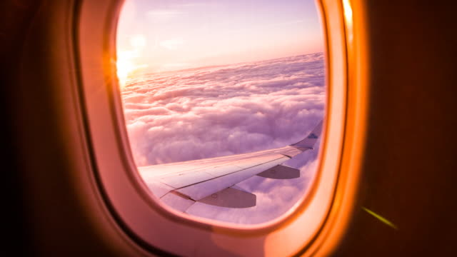 sunset through airplane window - aircraft wing stock videos & royalty-free footage