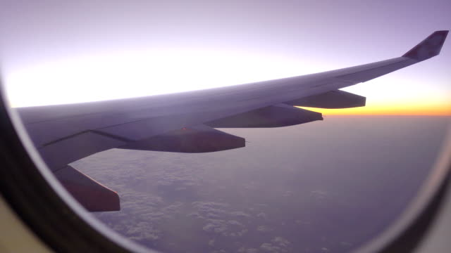 sunset through airplane window - abitacolo video stock e b–roll