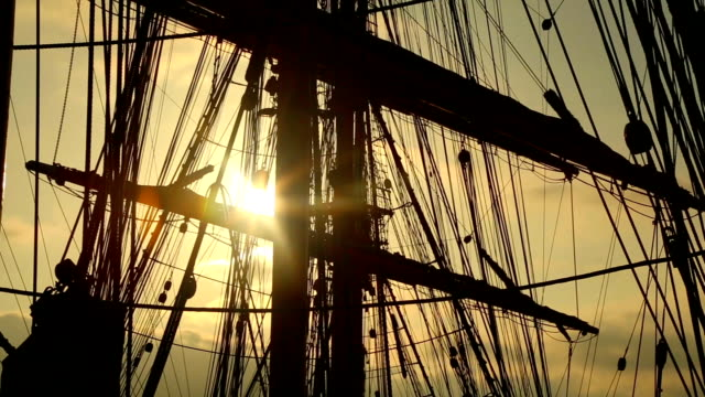 sunset through the rigging of a sailing ship - mast sailing stock videos & royalty-free footage
