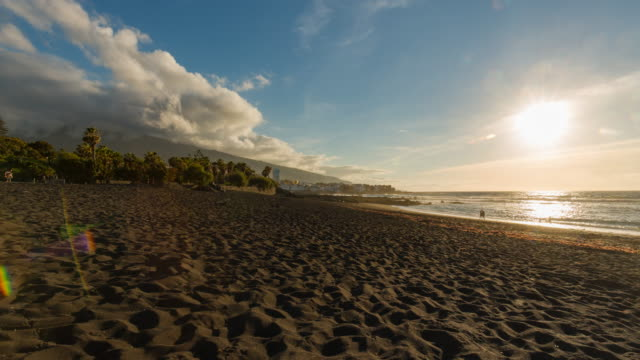 4K Sunset Time lapse at the beach in Puerto de la Cruz with a small coast town, Tenerife, Spain