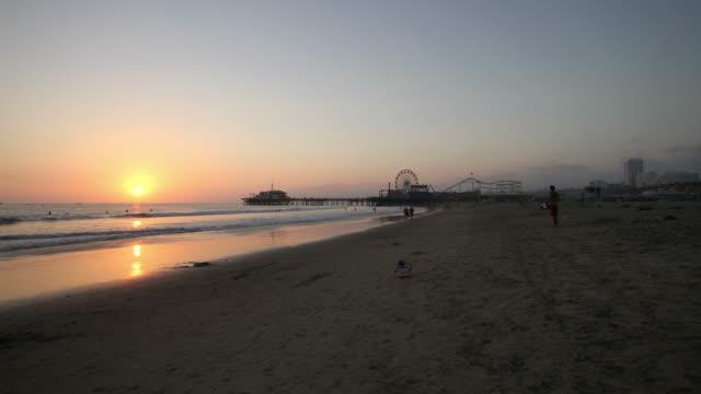 sunset time lapse from santa monica beach - santa monica sunset stock videos & royalty-free footage