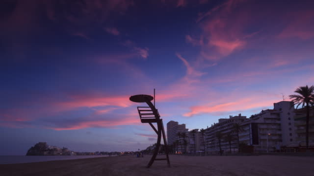 sunset time lapse in the beach of peniscola - lifeguard chair stock videos & royalty-free footage