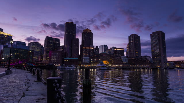 BOSTON - CIRCA 2014: Sunset Time Lapse of Boston skyline from the dock