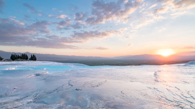 sunset time lapse of carbonate travertine pools at ancient hierapolis in pamukkale  denizli - hot spring stock videos & royalty-free footage