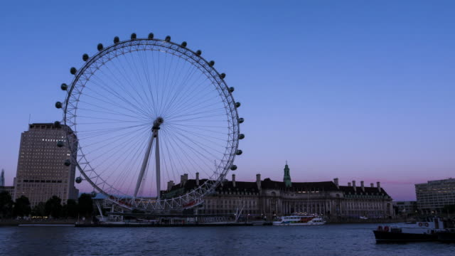 LONDON - CIRCA 2012: Sunset Time lapse of London eye during light show in London