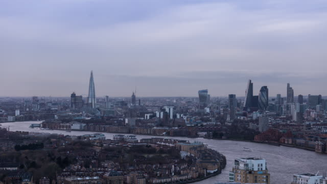 london - circa 2014: sunset time lapse of london from a high level roof top - sir norman foster building stock videos & royalty-free footage