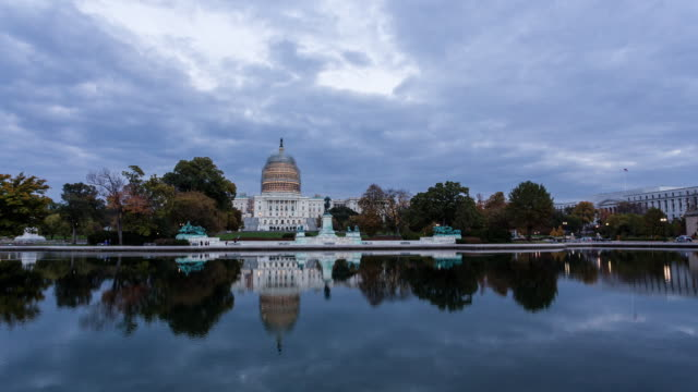 washingthon dc - circa 2014: sunset time lapse of the washington capitol in a sunny and cloudy day - government building stock videos and b-roll footage