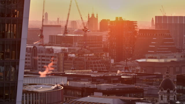 a sunset time lapse over the city of london - victoria tower stock videos & royalty-free footage