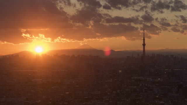 sunset time lapse over tokyo - sunset stock videos & royalty-free footage