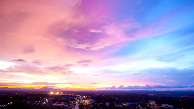Sunset Time-lapse against Cityscape at Trang Thailand