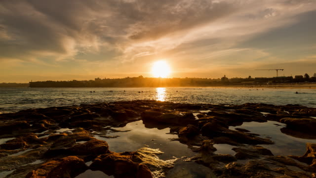 sunset timelapse at bondi beach, sydney with surfers and people in 4k - noelia ramon stock videos & royalty-free footage