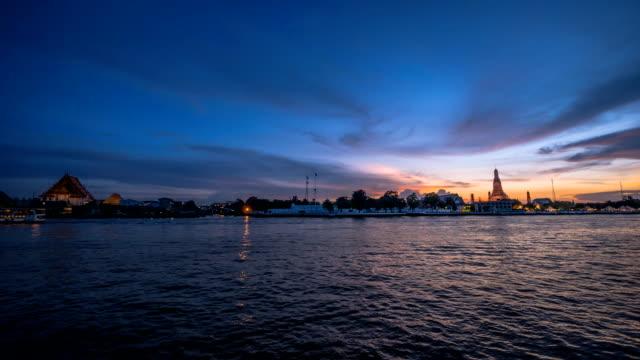sunset timelapse at chao praya river, bangkok, thailand - sunset to night stock videos & royalty-free footage