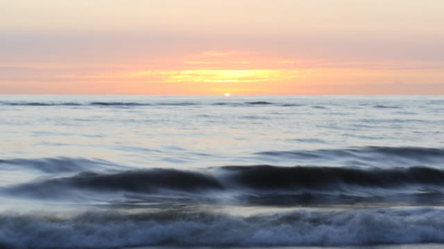 sunset timelapse at north sea beach - dramatic sky stock videos & royalty-free footage