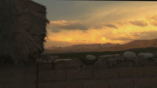 vídeos de stock, filmes e b-roll de sunset timelapse in the andes, bolivia - arcaico