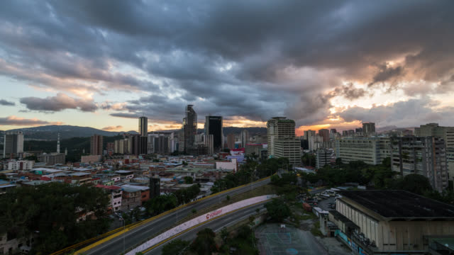 sunset timelapse of caracas skyline in venezuela - venezuela stock videos & royalty-free footage