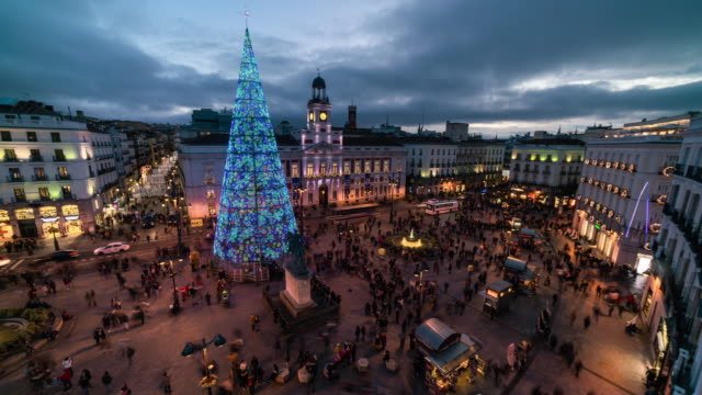 Sunset Timelapse of christmas light in puerta del Sol from a terrace in Madrid