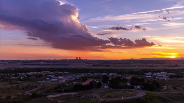 Sunset Time-lapse of Madrid Skyline and International Airport during a dramatic Storm clouds