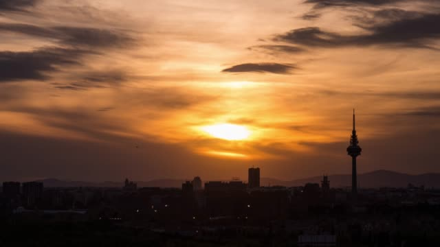 sunset time-lapse of madrid skyline - day to sunset stock videos & royalty-free footage