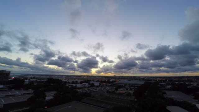 sunset timelapse of sydney airport - weather stock videos & royalty-free footage
