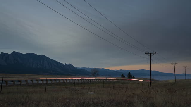 sunset timelapse of the mountains with traffic in boulder, co - boulder stock videos & royalty-free footage