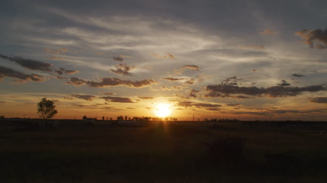 a sunset time-lapse shot - perfection stock videos & royalty-free footage