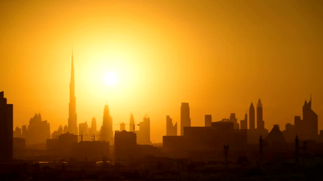 dubai sunset timelapse skyline - sunset stock videos & royalty-free footage