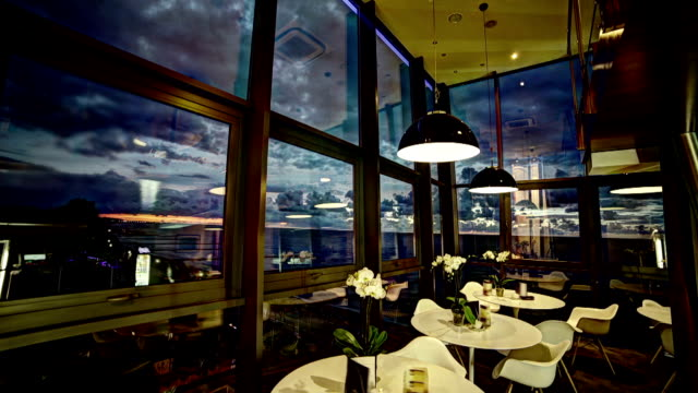 Sunset timelpase in restaurant interior