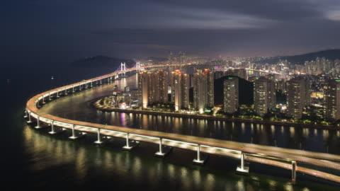 sunset to night cityscape along suyeonggang river and gwangan bridge / suyeong-gu, busan, south korea - island stock videos & royalty-free footage