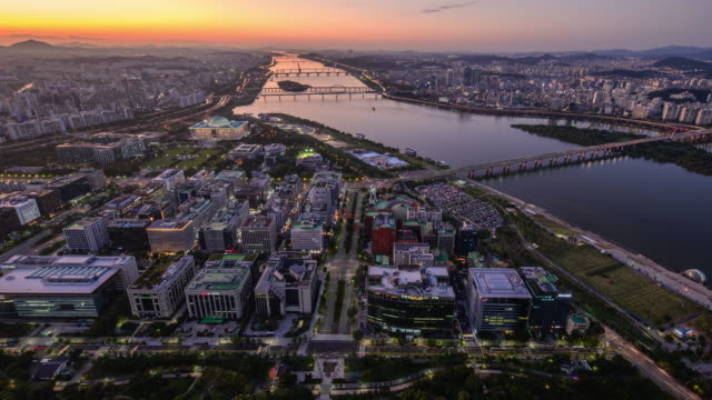 sunset to night cityscape around national assembly building and han river / yeouido, seoul, south korea - national assembly stock videos & royalty-free footage