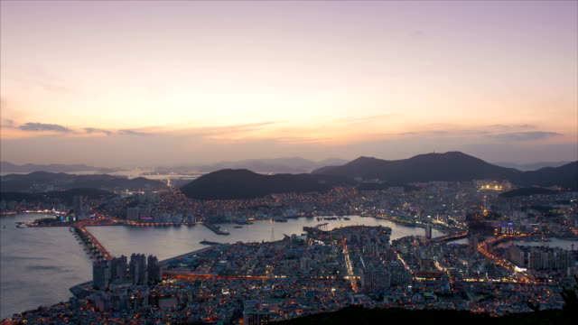 sunset to night cityscape of busan harbor / dong-gu, busan, south korea - wide stock videos & royalty-free footage