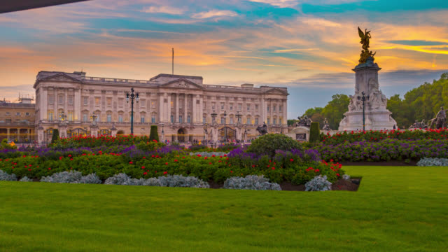 Sunset to night motion controlled timelapse sequence of lights coming on on Buckingham Palace in London