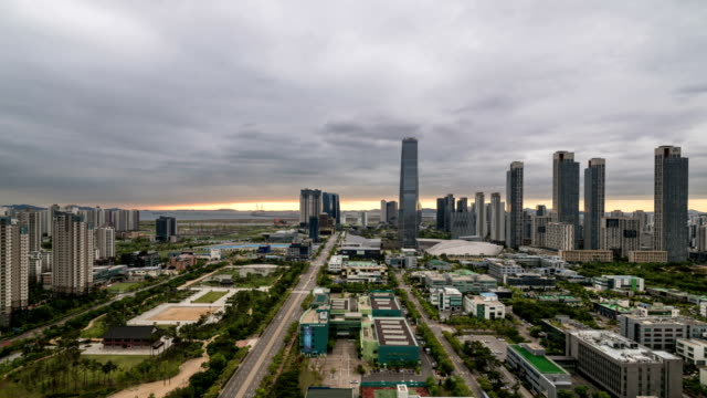 sunset to night scenery of songdo(international business district) - sunset to night stock videos & royalty-free footage