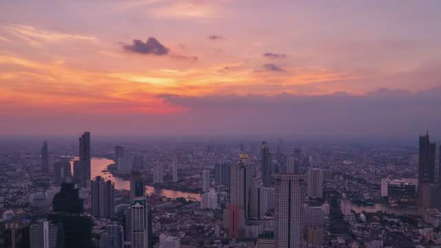sunset to night time lapse and tilt down: bangkok cityscapes and chao phraya river. - office block exterior stock videos & royalty-free footage