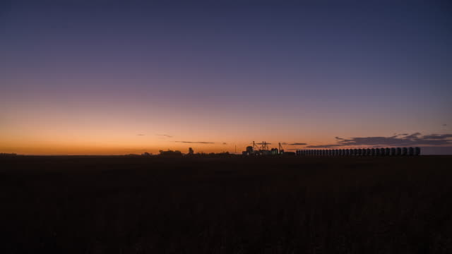 sunset to night time lapse of small town aberdeen, sk - prairie stock videos & royalty-free footage