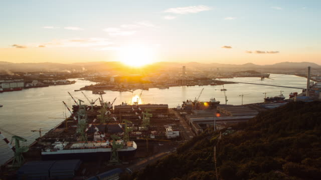 sunset to night time lapse of ulsan harbor bridge - sunset to night time lapse stock videos & royalty-free footage