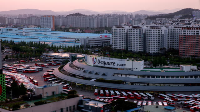 sunset to night view of gwangju central bus terminal - orthographic symbol stock videos and b-roll footage