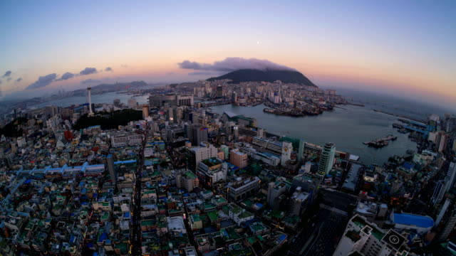 sunset to night view of jung-gu district and bongnaesan mountain with clouds - busan stock videos & royalty-free footage
