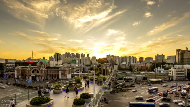 sunset to night view of people passing through seoullo 7017 (the first pedestrian road established recently in elevated road) and traffic moving in jung-gu - sunset to night stock videos & royalty-free footage