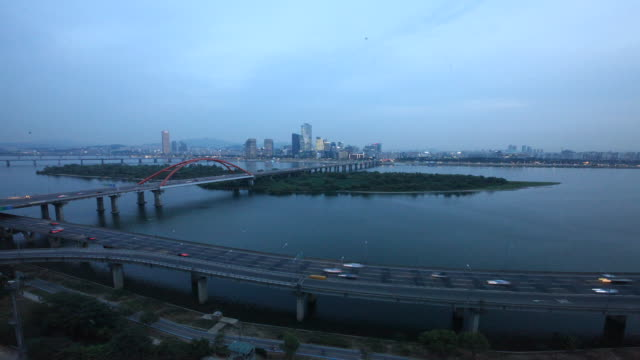 sunset to night view of seogangdaegyo bridge and yeouido business district on background - sunset to night stock videos & royalty-free footage