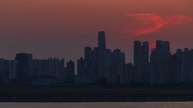 sunset to night view of songdo international business district (songdo ibd) / yeonsu-gu, incheon, south korea - romantic sky stock videos & royalty-free footage